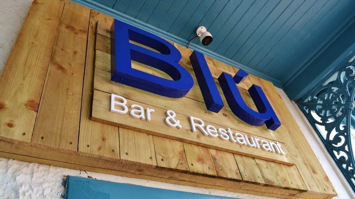 Blu Bar and Restaurant 3D logo above door in daytime in Dundee