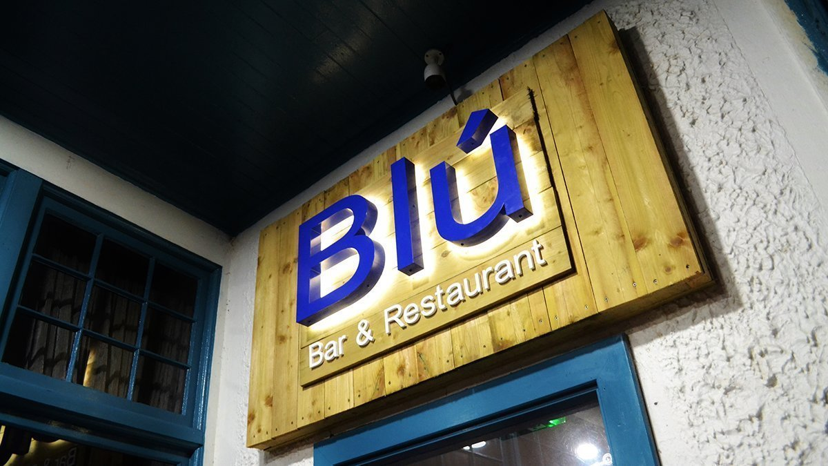 Blu Bar and Restaurant logo above door at night in Dundee